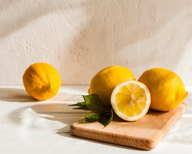Lemons arrangement on wooden board
