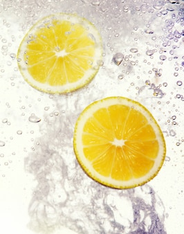 Lemons dropped into water