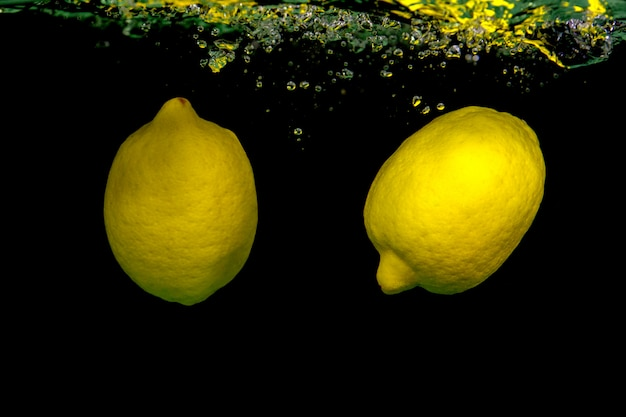Lemons falling into the water