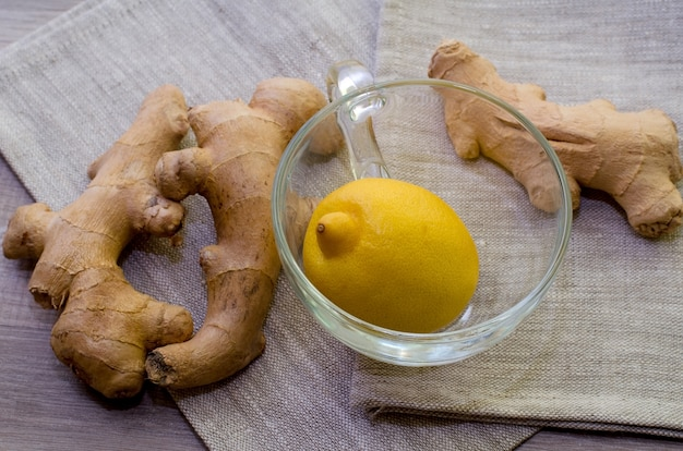 Lemons and ginger roots on gray  as a treat against seasonal flu