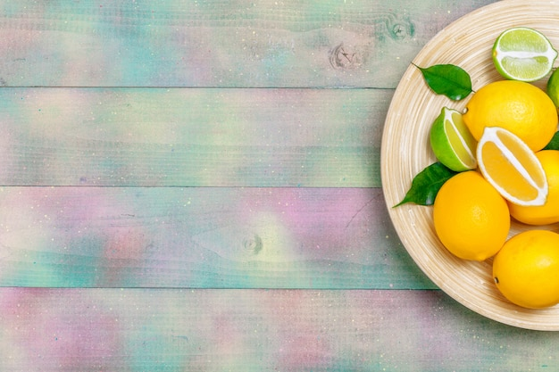 Lemons and limes on a wooden .