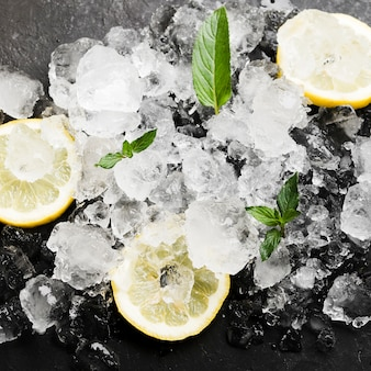 Lemons with mint and ice cubes