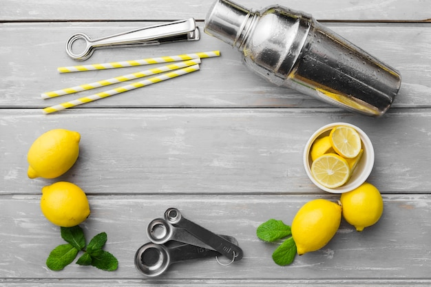 Lemons with mint and shaker