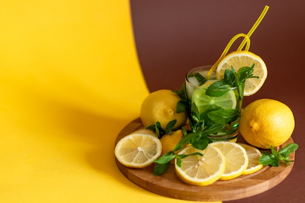 Lemons on a wooden board. cocktail with lemon