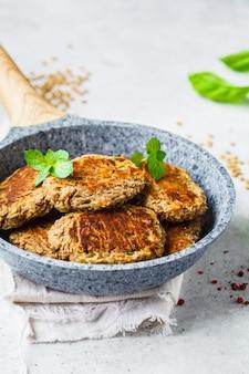 Lentil cutlets in gray frying pan. healthy vegan food concept.