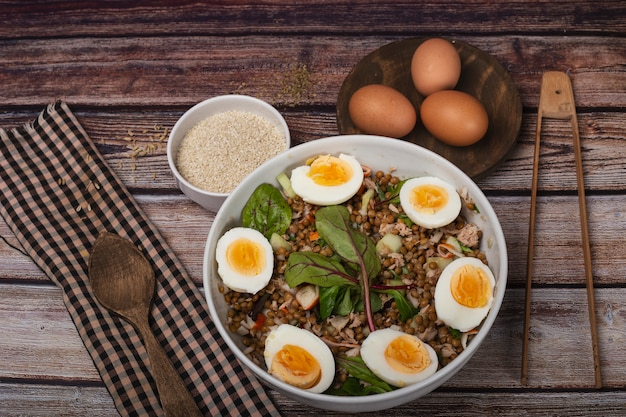 Lentil salad with vegetable sprouts and hard boiled egg.