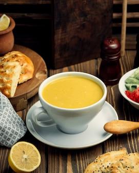 Lentil soup in a cup and lemon