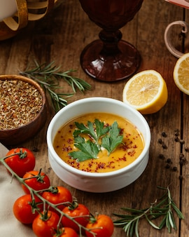 Lentil soup with spices vegetables and lemon