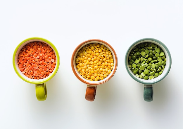 Lentils of different types and colors in portioned cups. vegan proteins.