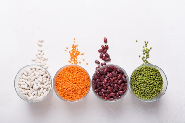 Lentils in glasses on the table. this legume contains a lot of vegetable protein. top view