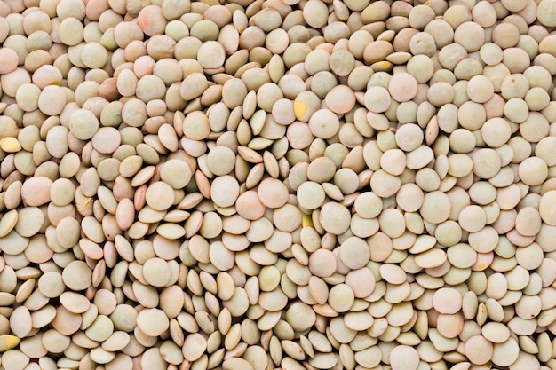 Lentils pulse legumes vegetables vegetarian food background.