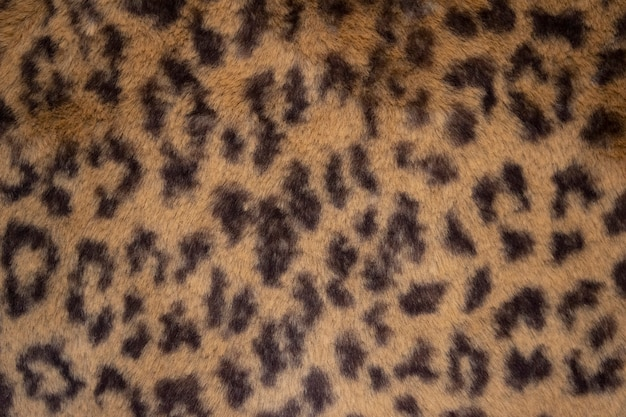 ヒョウのアニマルプリントのキャンバスの毛皮のテクスチャまたは背景