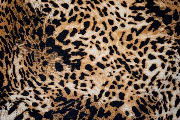 ヒョウのアニマルプリントのキャンバスのテクスチャまたは背景