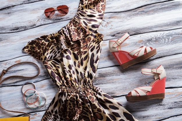 Leopard dress and bright bracelets. wedge sandals with luxury dress. new items at fashion boutique. exclusive clothing on sale.