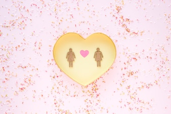 Lesbian couple on golden heart