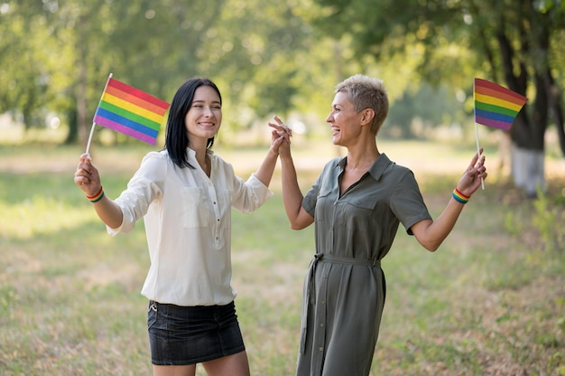 Lesbian couple in park with flags