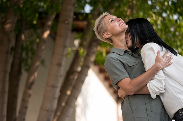 Lesbian couple in park