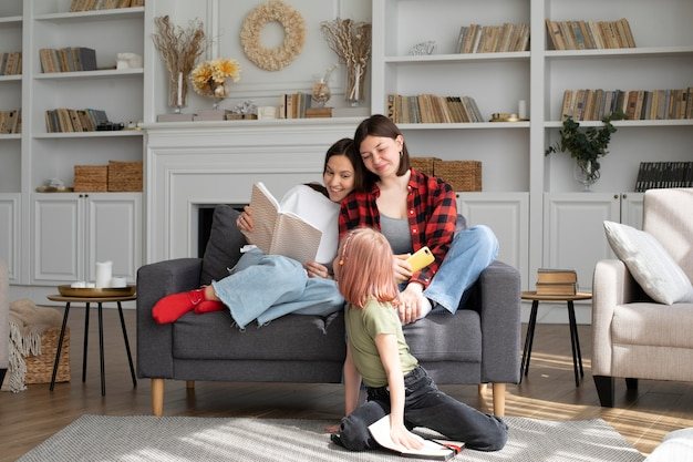Lesbian couple spending time with their daughter