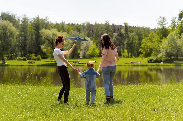 Lesbian couple spending time with their son in the park