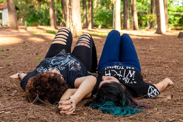 Lesbian girlfriends couple on a beautiful sunny day in the park.