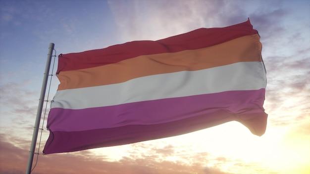 風、空、太陽の背景に手を振るレズビアンプライドフラグ。 3dレンダリング