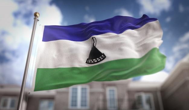 Lesotho flag 3d rendering on blue sky building background