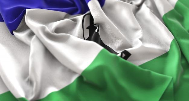 Lesotho flag ruffled beautifully waving macro close-up shot