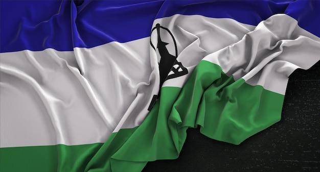 Lesotho flag wrinkled on dark background 3d render