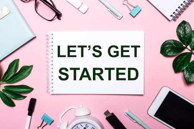 Let is get started is written in a white notebook