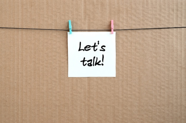Let's talk! note is written on a white sticker that hangs