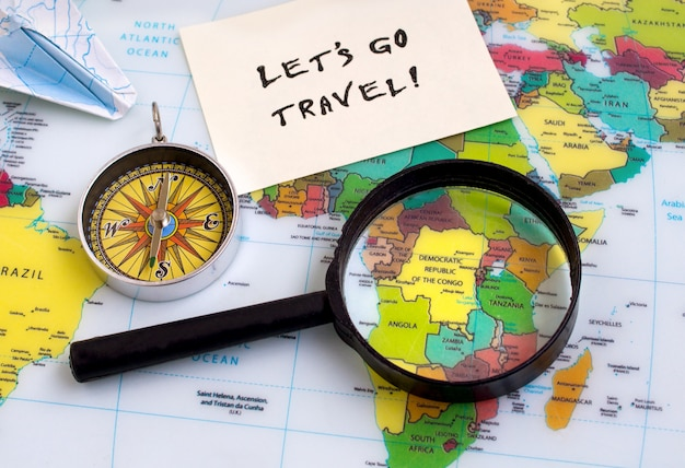 Lets go travel text words, country selection, map magnifier compass, background