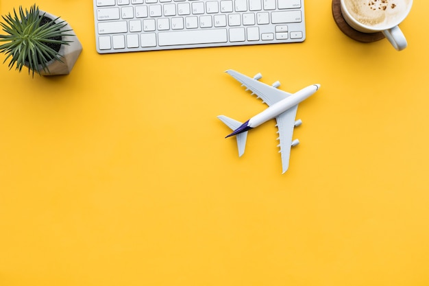 Lets go to travel or vacation after covid outbreak with air plane on desk