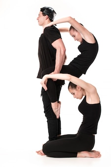 The letter b formed by gymnast bodies
