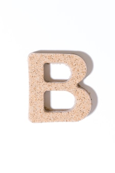 Letter b of the sand isolated in white summer concept alphabet