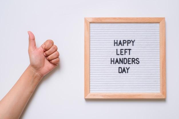 Letter board incription happy left hander day on white background