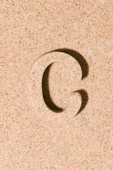 Letter c of the sand isolated on the beach sand concept of summer alphabet