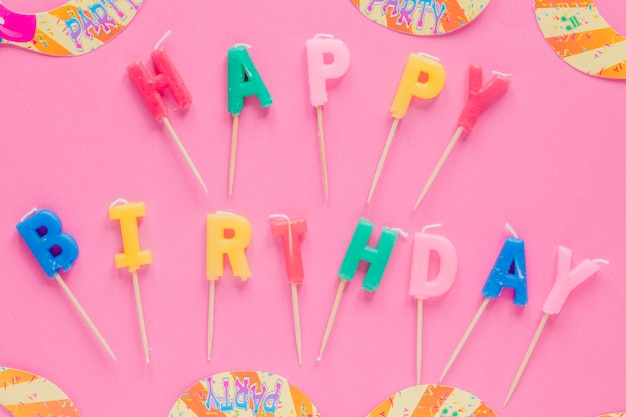 Letter candles on pink