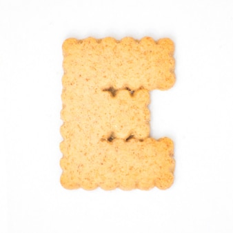 Letter e made of cracker cookie isolated on white background