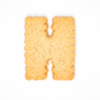 Letter h made of cracker cookie isolated on white background
