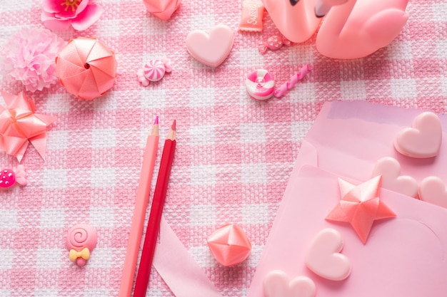 Letter love and valentine's day decoration on pink tablecloth texture background.