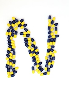 The letter n alphabet made of medical capsules