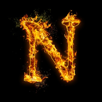 Letter n. fire flames on black , realistic fire effect with sparks.