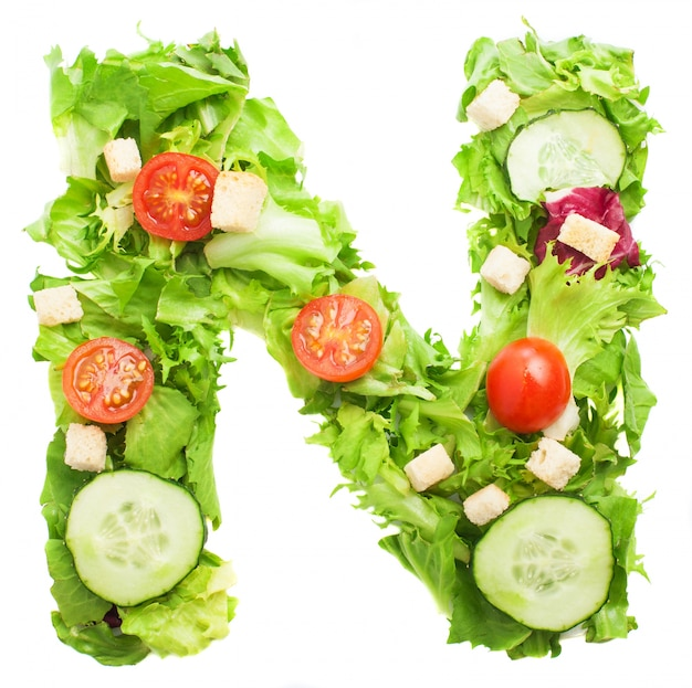 Letter n with slice of cucumber and lettuce