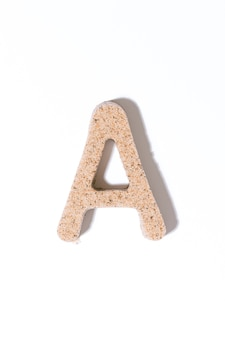 Letter a of the sand isolated in white summer concept alphabet