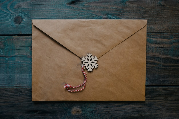 Letter to santa claus, envelope with wooden christmas decor in the form of wax seal