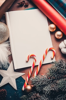 Letter to santa claus with christmas decorations and caramel
