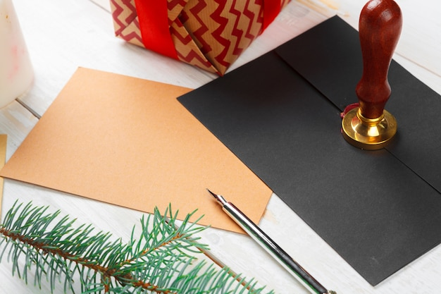 Letter to santa claus with sealing wax stamp on wooden table