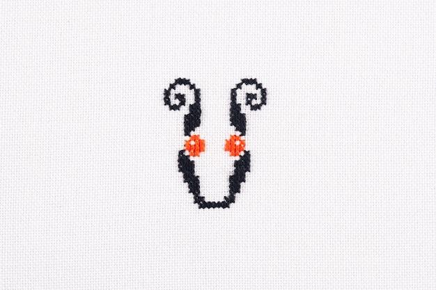 Letter u of embroidered cross stitch latin alphabet linen fabric handmade