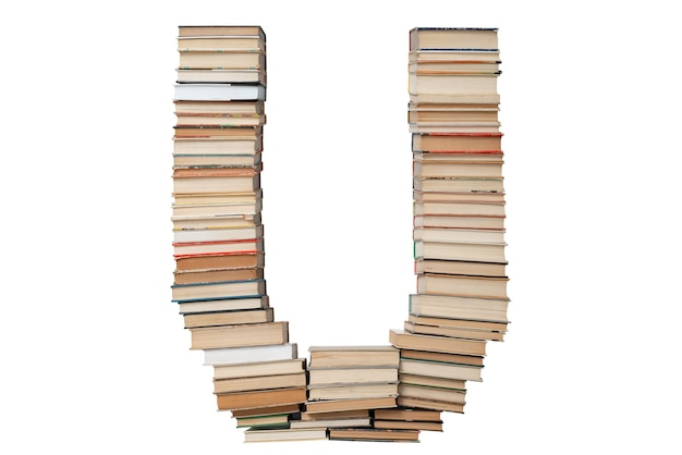 Letter u made of books isolated on white