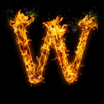 Letter w. fire flames on black , realistic fire effect with sparks.